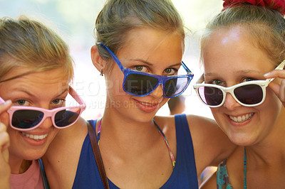 Buy stock photo Cropped shot of a group of girlfriends at an outdoor festival