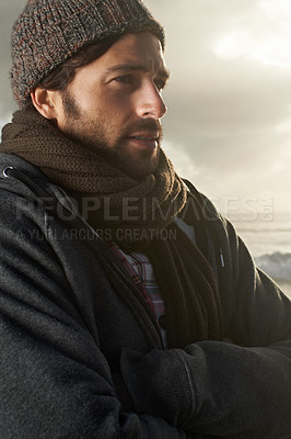 Buy stock photo A handsome young man at the beach