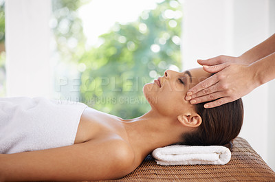 Buy stock photo A young woman receiving a face massage