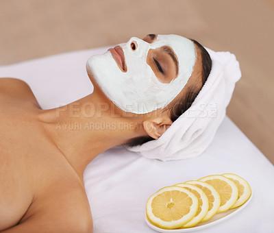Buy stock photo Shot of a young woman enjoying a facial treatment at a spa