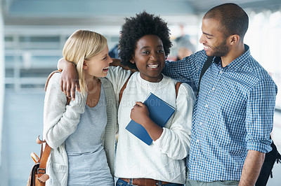 Buy stock photo A group of college students standing together and smiling