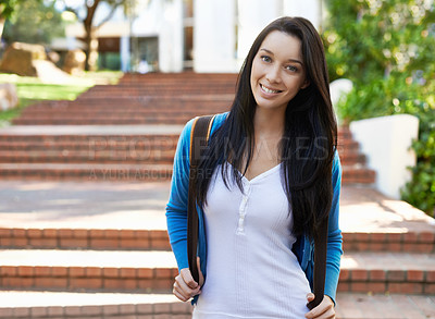 Buy stock photo Cropped view of a young female student standing outdoors with her backpack