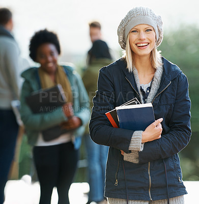 Buy stock photo Portrait of a young student standing outside with friends in the background