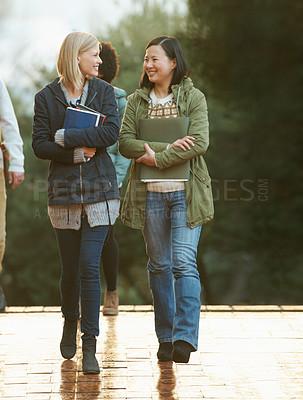 Buy stock photo Cropped shot of university students on campus