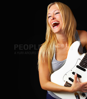 Buy stock photo A young woman playing an electric guitar