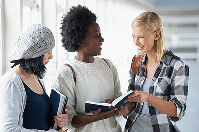 Buy stock photo Shot of a group of female College students standing the a corridor waiting for class