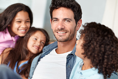 Buy stock photo A father spending time with his 3 children