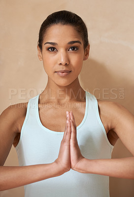 Buy stock photo An attractive young woman practising the art of meditation
