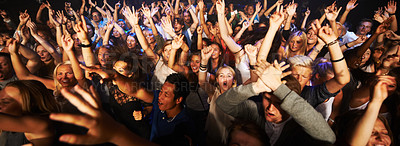 Buy stock photo Shot of a large crowd at a music concert- This concert was created for the sole purpose of this photo shoot, featuring 300 models and 3 live bands. All people in this shoot are model released