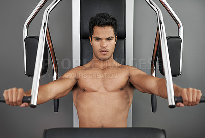 Buy stock photo A fitness shot of an athletic young working out