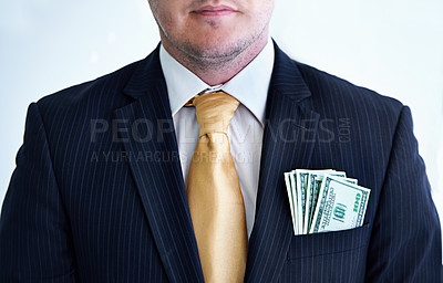Buy stock photo Cropped shot of a businessman with money in his pocket