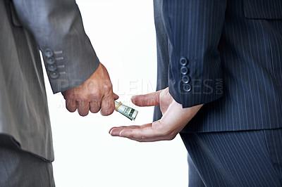 Buy stock photo Cropped studio shot of money passing between two businessmen's hands