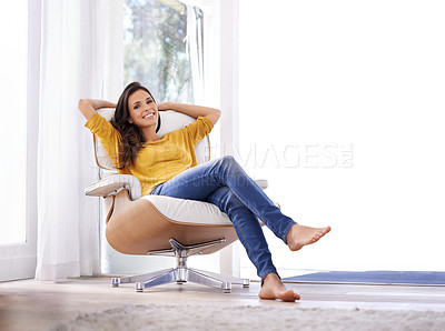 Buy stock photo A woman relaxing on a chair with her hands behind her head