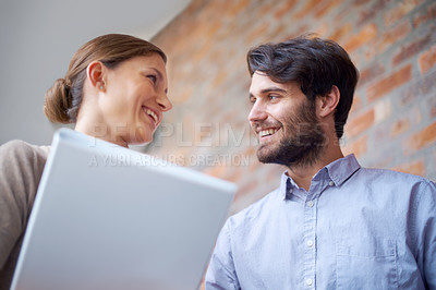 Buy stock photo Shot of a two young office professionals talking together