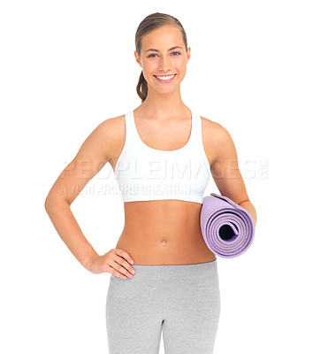 Buy stock photo Studio portrait of a sporty young woman holding an exercise mat against a white background