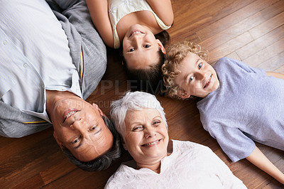 Buy stock photo High angle view of a brother and sister bonding with their grandparents