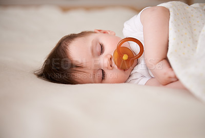 Buy stock photo Cropped shot of a baby boy sleeping peacefully