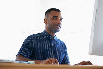 Buy stock photo An African-American man working on his computer