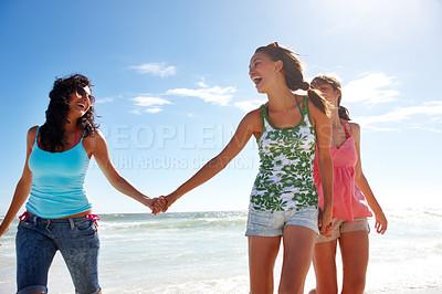Buy stock photo Portrait of three happy teenage friends at the beach