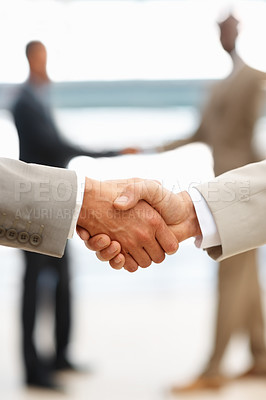 Buy stock photo Closeup of business people shaking hands, act of agreement