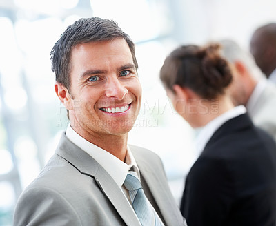 Buy stock photo Portrait of a handsome joyful business man smiling confidently