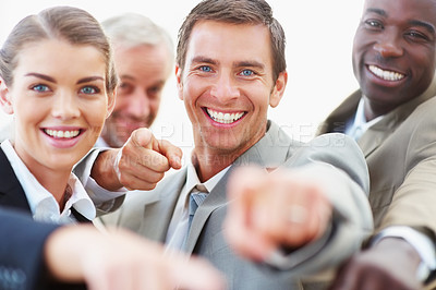 Buy stock photo A group of successful business people pointing towards camera and smiling