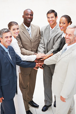 Buy stock photo Portrait of business colleagues smiling with their hands together