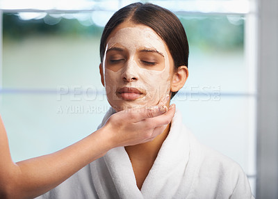 Buy stock photo A gorgeous woman having a face mask applied
