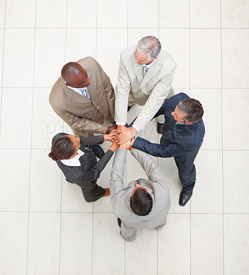 Buy stock photo Upward view of a group of business people with their hands together in unity