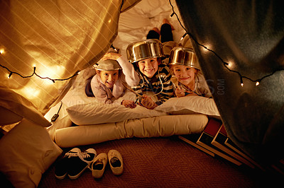 Buy stock photo Shot of cute little children with pot helmets in a blanket fort