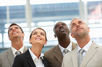 Buy stock photo Group of happy business people looking upwards
