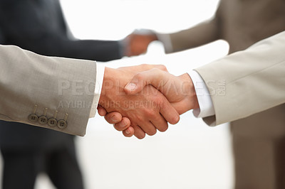 Buy stock photo Closeup of business people shaking hands at the workplace