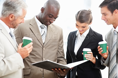 Buy stock photo Successful business partners busy in of a conversation over white background