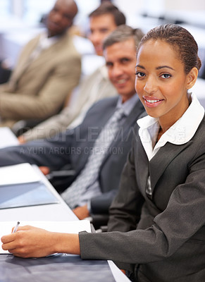 Buy stock photo Cute young business woman with colleagues at a conference
