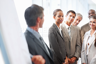 Buy stock photo Group of business colleagues being lectured by a speaker at a conference