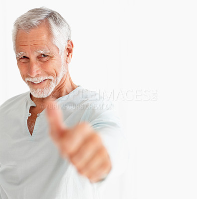 Buy stock photo Portrait of a happy mature man showing a thumbs up on white