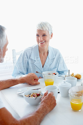 Buy stock photo Healthy lifestyle: Old couple having breakfast at the table