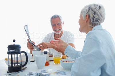 Buy stock photo Charming old couple having a healthy breakfast in the morning