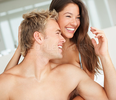 Buy stock photo Happy young couple at home having a good time on the bed