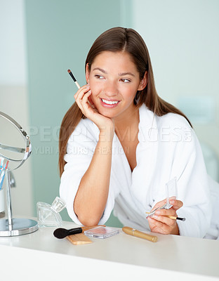 Buy stock photo Young woman day dreaming while grooming after a bath