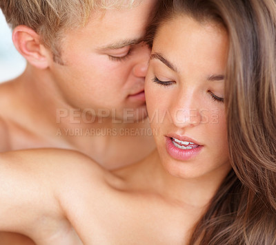 Buy stock photo Closeup of an intimate couple enjoying at the act of foreplay