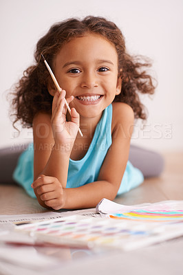 Buy stock photo Shot of a little girl painting a picture of a rainbow