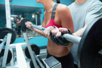 Buy stock photo Shot of an attractive young woman and her trainer in the gym