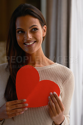 Buy stock photo A beautiful woman holding a red heart shaped card