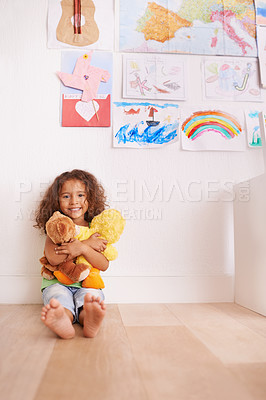 Buy stock photo Portrait of a cute little girl hugging her stuffed animals