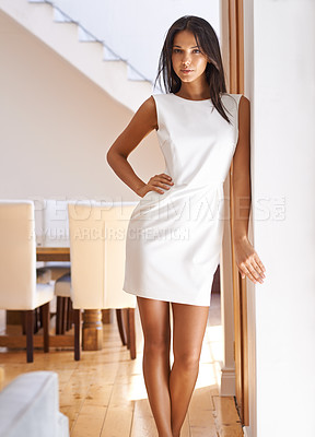 Buy stock photo Portrait of an attractive young woman standing in a doorway in her home