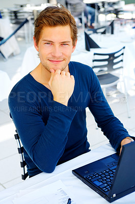Buy stock photo  Young man with his laptop