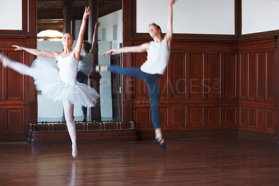 Buy stock photo Portrait of two ballet dancers dancing gracefully in front of a mirror