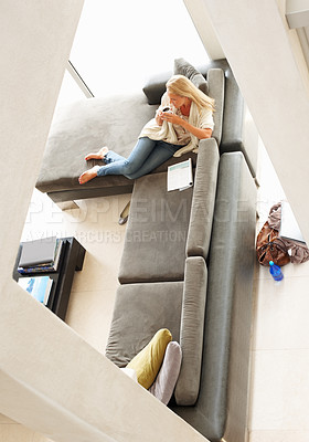 Buy stock photo Mature woman relaxing in a beautiful apartment having a cup coffee