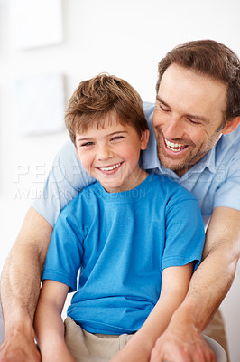 Buy stock photo Portrait of a handsome young man with small boy laughing together - Indoor